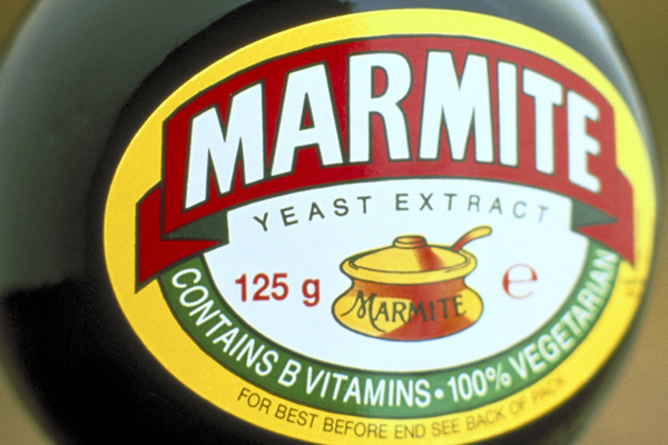 A jar of Marmite in close up detail.